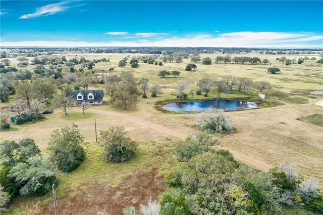 House and +/- 15 acres just outside the city limits of Giddings, TX! Beautiful post oak trees scattered throughout the property with wooded area in front to give seclusion and privacy from the highway. Additional acreage available.