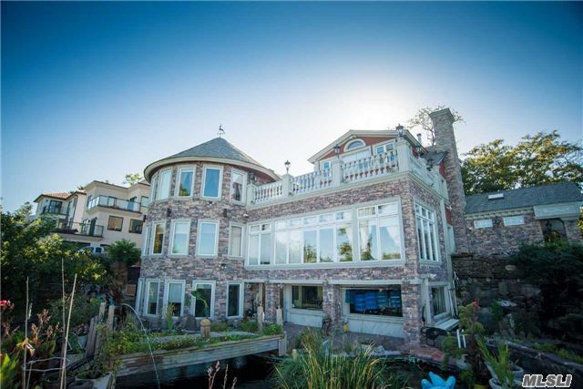 This Converted Waterfront Colonial Has 5 Bedrooms And 4.5 Baths Dispersed Across 6,256 Square Feet. Facing The Neighborhood Is A 2.5 Story Stucco Exterior With A 2-Car Garage And Stone Driveway. Facing The Bay Is A 3 Storied Stone Tower (Built In 2008) And 2.5 Story Stone Exterior Bedecked With Bay Windows, Stone Walkways And Monuments. (See Attachment For More)