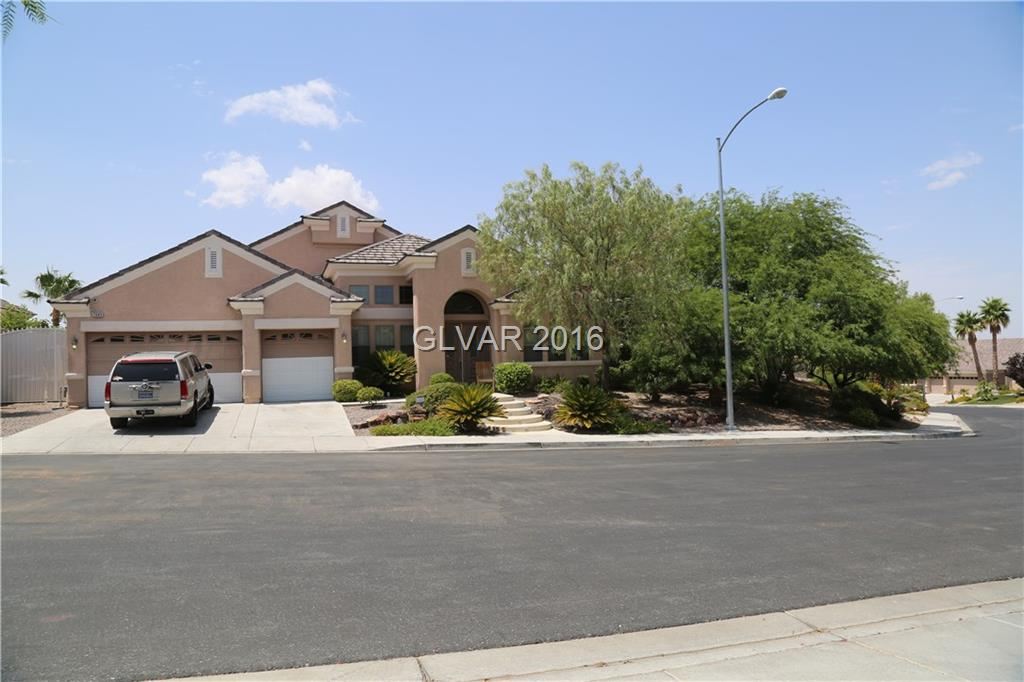 Single Story, elevated with City and Mountain Views, oversized lot, covered patio, wood flooring, granite counters, high volume ceilings, 3 car garage.  4 bedrooms plus office, 3 bedrooms with private baths, family room w/built-in entertainment center, surround sound, stainless steel Jen Air appliances. Pool/spa w/removable child safety fence, built in BBQ, large childrens play area.