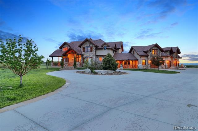 A setting like none other. Prestigiously situated on a nearly 2-acre corner lot on the famed Buffalo Ridge in Castle Pines North, this completely custom-built home enjoys dramatic views from Pikes Peak to downtown Denver. Overlooking the expansive rolling hills of Daniels Park and the majestic buffalo herd, this exclusive setting will make one feel as though they have stepped back in time and are living a true Colorado lifestyle with the conveniences of today's modern life. Mountain contemporary inspired architecture combined with stylish accents reminiscent of an Italian countryside estate make this home one of a kind. Located just minutes from several of Colorado's finest golf courses, shops, and schools, this home and setting are sure to impress buyers from all walks of life.