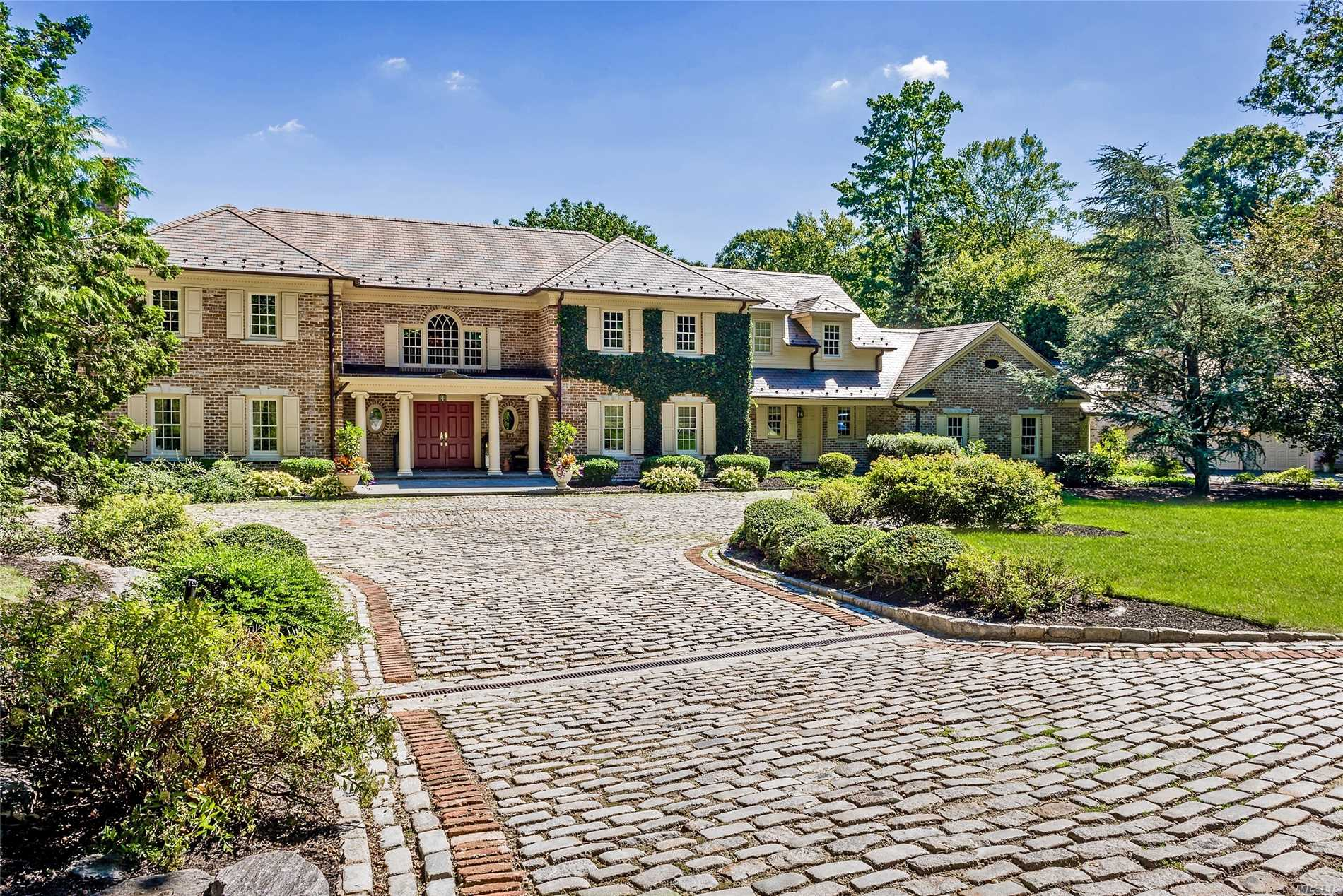 Impressive Gated Entry,Long Drive Leads To Beautiful Brick Manor Home,6900 Sq Ft,Sited On 5 Lush Acres In A Private Yet Convenient Setting.Estate Incl Huge Heated Gunite Pool,Brick Pool House W/Service Bar & Full Bth,Sep Guest Quarters Over 3-Car Gar, & A (Rare) Lighted Har-Tru Tennis Court.Backing To 13 Acres Of Natural Preserve, This Residence Embodies The Elegance That Makes Matinecock So Desirable. Classic Architecture Yet Unique,With 9' Ceilings,Radiant Heat,4 Fpl, See Update List!