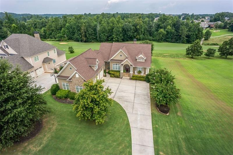 Your own golf resort! Meticulously maintained 5BR/4.5BA home in desired Traditions of Braselton golf community!Home boasts gorgeous updates & stunning views of golf course. Full finished ter lvl,bonus upstairs ste w/full bath — perfect for an addt'l teen ste,movie rm,play rm,or large office,master on main,gorgeous refinished decks & screened porch on upper lvl & patio on lower lvl,all overlooking the fairway!Entertainer's DREAM! Terrace finished w/full custom bar&walk-out patio. Home warranty included w/sale of home!See the views from this home's relaxing outdoor decks.