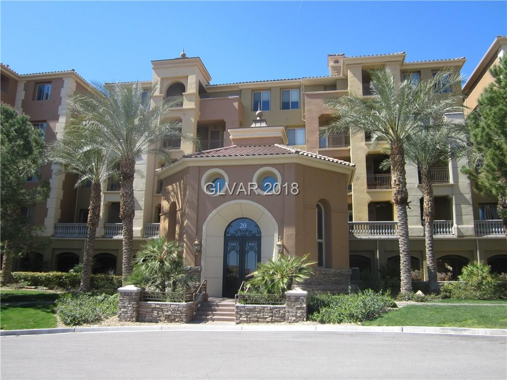 Beautiful Lake Las Vegas condo in guard gated community in south shore golf club. Nice large courtyard entry, travertine and wood flooring, upgraded cabinets with granite counters, all stainless steel appliances, wet bar with fridge and sink, nice fireplace, master bedroom separate from second bedroom, master has separate tub/shower and large patio out back with views.
