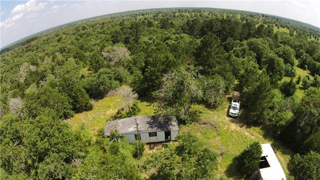 Beautiful 30.807 acres virtually untouched almost 30 years. Water meter/Electricity on property. In Ecolab University study to convert property to Wildlife exemption. Seller paid legal & 2018 fees (+/- $11k) towards the 2 year conversion/study program.Talk to agent for criteria/terms. Loblolly Pines, meadows, blue stem grasses, hardwoods, trails, pond. Wildlife: Deer, wild hogs, bobcat, birds & more. 2 Morgan buildings poor condition but one is 'redeemable'.Owner/Broker