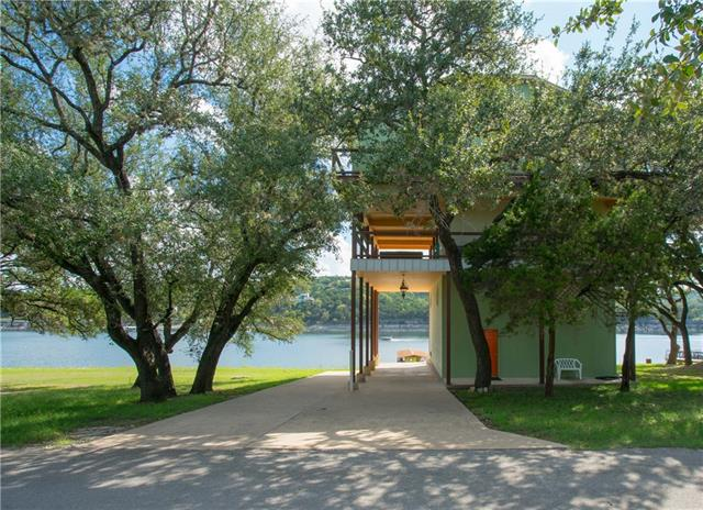 """AMAZING location! Lake Travis deep-water main channel 3-story tree-house style home. Over an acre. 360 decks, huge 2nd story outdoor covered living space w/hot tub + guest suite w/full bath (not incl. in tax record sq. footage). Steel framing, 3"""" of concrete between floors. Huge boat dock w/cabin & boat lift. 110' boat ramp + property-owners-only boat ramp close by. Loft storage w/1-ton hydraulic crane. Giant garage and carport w/14' ceilings. Property-owners-only park next door, so an unobstructed view!"""