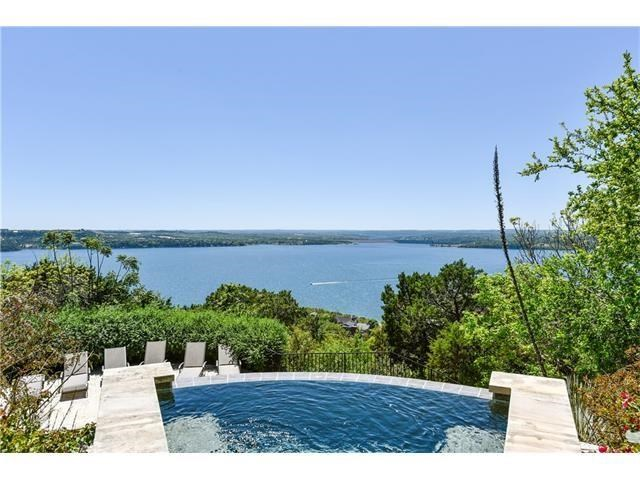 Magnificent Panoramic Lake Travis Views! Tuscan-inspired, gated estate with a dramatic entrance. Beautiful outdoor entertaining with cascading pool & hot-tub overlooking Lake Travis. Inside is a two-level floor plan with a first-floor master, lots of built-ins and custom work, massive kitchen with Kitchen Aid stainless steel appliances and a large island for entertaining and cooking. Climate controlled 500+ wine cellar 4 bedrooms, 4.5 baths, 3 car garage, breathtaking Lake Travis views from most rooms.
