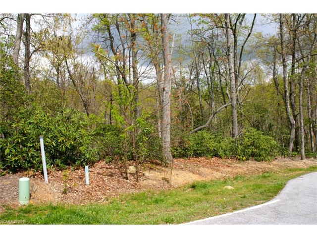Builder friendly lot in gated golfing community. Suitable for single level home or home with lower level walkout. Lots of hardwood and mountain laurel.
