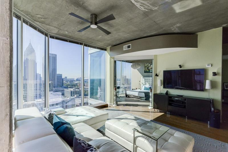 Breathtaking skyline views and luxury amenities differentiate this sleek 26th floor CORNER unit condo at Spire Midtown! Wake up to a 180 degree view of Atlanta! Kitchen opens to the living area, with floor-to-ceiling windows & ample dining space. Large master bedroom also has stunning views, walk-in closet, and master bathroom with separate tub/shower.  Secondary bedroom is currently used as an office and has features additional fabulous floor-to-ceiling windows. Amenities include concierge, gym, rooftop pool, business center, security and more. Enjoy everything Atlanta has to offer, just outside your front door!