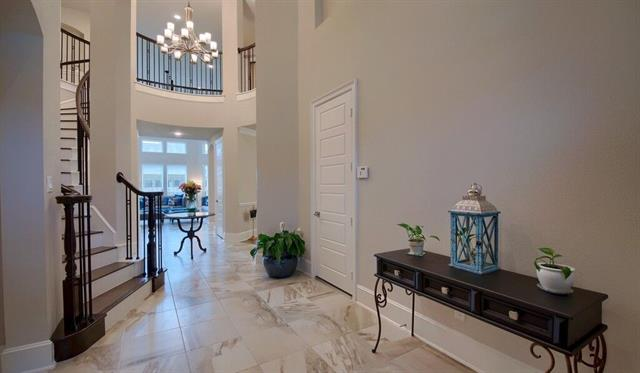 Westin Homes Hopkins floor plan.  Impeccable home with exquisite feautures.  Gourmet kitchen with 6 gas burner cooktop, Quartz countertops with waterfall edge, Kentmoore Yorktown raised dover gray cabinet doors, Apron front sink, and 10 x 15 Marazzi Oxford Cacao horizontal backsplash tiles.  Grand foyer with study to the left.  Cascading stairway and eye catching light fixture as you enter the home.  Master suite downstairs with lavish bathtub and oversized shower.  Brushed nickel finish on faucets.