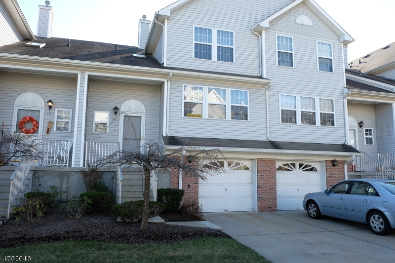 Georgian Classic Townhouse with Garage...Located in the Desirable Oak Hill...Excellent Condition!  Kitchen and Breakfast Room with Wood Flooring and a 2 Story Ceiling with Skylights and Ceiling Fan...