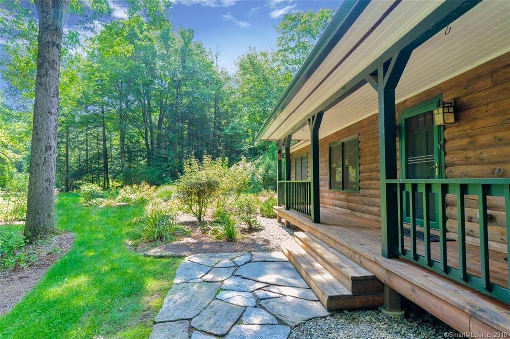 The sounds of nature and breathtaking 3.82 level acres overlooking Simpaug Pond. Screen Porch And Deck. 1994 Custom Built Log Home with modern  amenities. Central air. Chef's Kitchen. Minutes to Metro North. 5 Minutes to Bethel town center to enjoy the Bethel Cinema, fine dining and Caraluzzi's Gourmet Supermarket. 10 Minutes to Ridgefield center. Perfect. Land adjacent to Holbrook's Organic Farm - fresh produce, pies and flowers year round.