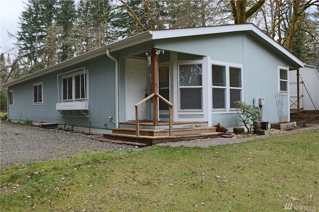 Great country feel, yet close to West Olympia! Over 1500sf rambler, vaulted ceilings in the living and dining rooms, nice bright bay window eating nook, large kitchen w/lots of cabinets and counter space! Spacious master w/walk-in closet and private bath. 2nd big bedroom plus french doors leading to den/office, large laundry room w/great storage! Covered back deck surrounded by wooded privacy! Fruit trees, garden space, green house, outbuilding, RV Parking, fire ring, and more! Tumwater Schools!