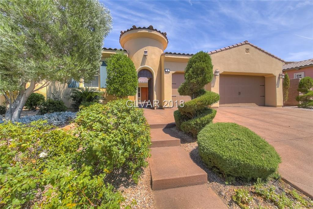 Stunning single story home in gated community of beautiful Lake Las Vegas.Courtyard entry w/large fireplace.Spacious gourmet chef's kitchen w/granite counter tops, tile back-splash & stainless appliances.10 ft ceilings.Master bath features granite counter tops, tile flooring & spacious walk-in closet.Additional Bedroom could be used as MULTI-GEN quarters w/sink, mini-fridge & microwave.Backyard has poolsized lot & includes above ground hot tub.
