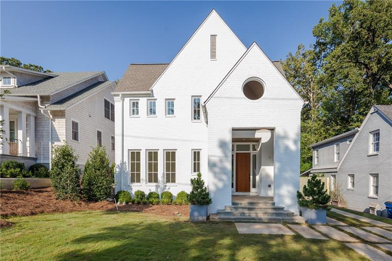 Stunning New Construction by Junger Homes in Peachtree Heights! Minimalist, modern design w/white painted brick & cedar shingle exterior, large steel casement windows/doors, bluestone terrace, lush landscaping & flat walk-out backyard w/great outdoor living space! White washed oak floors & incredible Kitchen w/integrated Thermador appliances, white quartz countertops & custom cabinetry. 10' ceilings. Huge finished 3rd level Bonus Space, spacious Master w/gorgeous white marble Bath, huge shower & double closets. Truly beautiful & within walking distance of the Duck Pond!