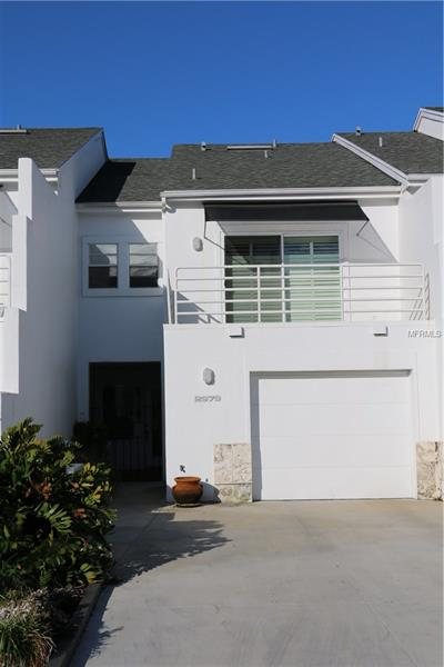 Remarkably stylish condo unit is located near Bayshore Blvd at the corner of MacDill & Knights. Situated in a small cluster of townhome style residences (25 in all), this unit features Saltillo tile floors downstairs, Bahama Shutters, completely updated kitchen & bathrooms, a wood-burning fireplace, screened patio, large bedrooms - each with own bath, and a third level loft ideal for an office/den/personal space with skylights. Loft makes combined sq ftg area 1700. A recent assessment already paid by owner provided for new concrete drives, renovation of pool area & pool furniture, new fencing & completely new landscaping & accent stone project currently being started. These places don't become available very often. Come see!