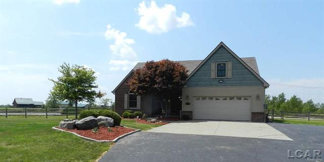 Magnificent Property with 6 acres, pond, outbuildings and 3 horse pastures.  Gorgeous home with an abundance of natural light features an open floor plan, beautiful first floor master suite with fireplace, fabulous kitchen with all of the appliances included, large office/den, upper level with 2 large bedrooms, bonus room and full bath, finished basement with large family room or recreation room (pool table included), plenty of room for storage. Home has dual sump pumps and a whole house generator.  Fantastic deck off back with views of the property and pond.  Attached garage is heated and has sink and cabinets.  Incredible horse barn with 11 large stalls, wash rack, garage doors and large area for storage/vehicles.  Additional barn has updated electric, insulated, eposy floor, office area, radiant heat and an 11 foot garage door.  Driveways and parking areas are all paved.