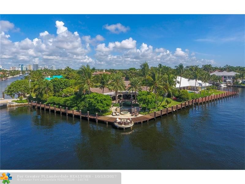 Breathtaking waterway views, Point Lot boasting 275 feet of deep waterfront. 2 power stations & enormous straight line dockage for 2 large yachts. Exquisitely updated warm contemporary estate. The custom open kitchen is a masterpiece with waterway views from the dining area. Oversized great room, media room. home gym & lrg master suite with 2 master bathrooms. Large cover loggia & full summer kitchen overlook the infiniti pool & spa. Full generator,  beach club, marina & guard house entry. Sq ft from bcpa