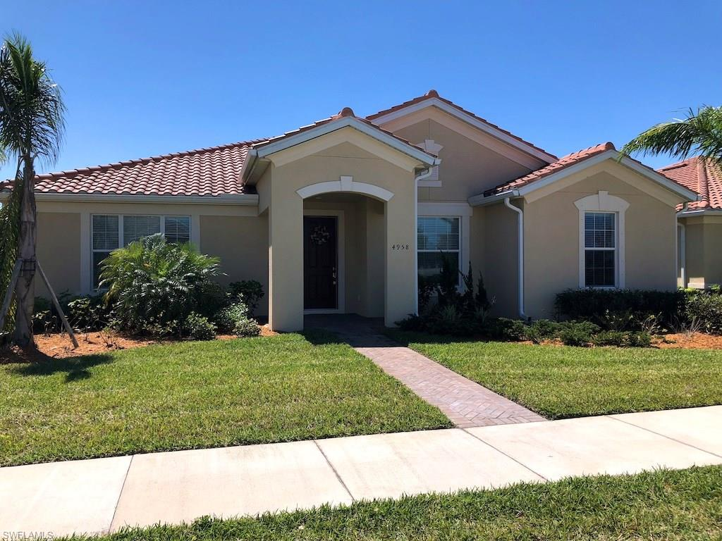 ***REDUCED*** Welcome To Your New Home! This Beautiful House Is Located Within Walking Distance To The Popular And Desirable Towncenter Of Ave Maria! Built In 2016, This Sandpiper Floor Plan Offers Nearly 1900 Sqft. Of Living Space, Comprised Of 3 Bedrooms, 2 Baths, And A 2 Car Attached Garage. Several Upgrades Were Added To This Home Such As Granite Counters, Cherry Wood Cabinets, Laundry Pre-Plumbed For A Tub, And Custom Landscaping. This Property Features Southern Exposure, And There Is Plenty Of Room For A Swimming Pool. Kitchen Features Large Island With Sink And Breakfast Bar, And The Open Floor Plan Is Ideal For Entertaining! Master Suite Features Walk-In Closet And A Huge Bathroom With Large Walk-In Shower, Dual Sinks, And Granite Counters. This Home Is Truly Spectacular, And It's In Impeccable Condition! Right Out Your Front Door Is One Of Several Beautiful Lakes With Sidewalks To Get Out And Enjoy The Weather That Makes SW Florida So Desirable. This Home Is Priced To Sell Under $300k, So Don't Delay... Come Get Your Slice Of Paradise Today!!