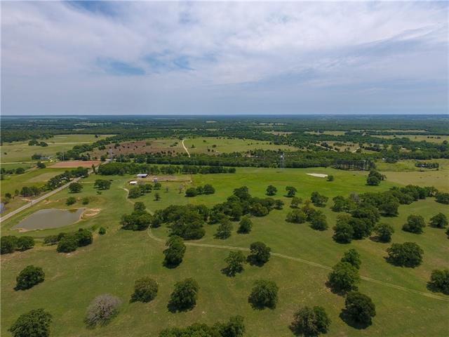 Unique ranch/horse property on 39+ acres w/ sandy loam soil, mature oak trees, rolling hills, improved coastal pastures & 2 stock tanks. Improvements include a 300'x150' lighted roping arena, judge's booth, large barn (could be converted to horse barn), sorting pens & chute, full perimeter fence & cross fenced. Updated 768 sq ft, 3 room cabin on the property.  Once used as a commercial rodeo facility. Well on property, not currently used. Owner financing available! Seller owns 50% minerals. Ag exempt.