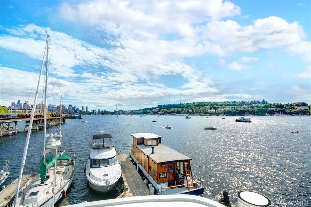 Once in a Lifetime! Perfectly located in Eastlake on Lake Union, custom House Boat Simpatico offers a Luxurious Lifestyle at your own slip at Roanoke Reef  Eat Sleep Work Play on 3 levels, 4 decks, rooftop space. 1200 SF living space 20'X 85' slip on condo dock, 65' House Boat 1 secured parking/storage,4 kayaks, 16' runabout! CAT5 Views City Mountains Space Needle GasWorks. New Dock in process.  EZ to City Transit Amazon Freeways  Walk to Serafina, Restaurants, Services, Pete's! ENJOY LIFE!