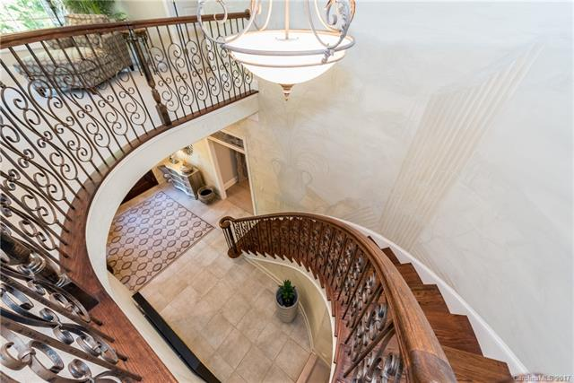 From the moment you enter the grand foyer of this stately Forest Hills home you will be amazed at the stone features and elegance throughout this home.  Kitchen has tons of counter space and cabinets for storage.  Large master suite with sitting area has a bath with a garden tub and tile shower.  Large bonus room perfect for relaxing or enjoying hobbies.  Hot tub and inground pool outside are surrounded by a patio with tons of privacy from trees.  Immaculate, updated, and ready to move in home!