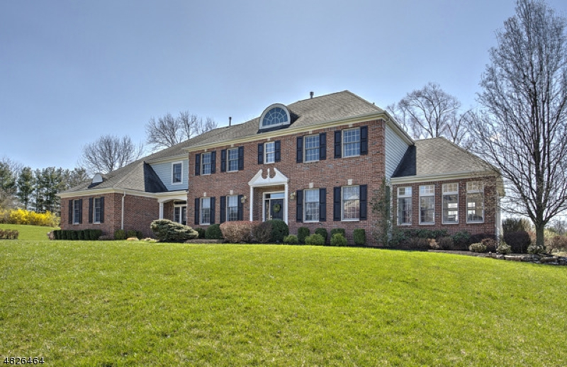 Stunning Colonial at Stanton Ridge. Country club lifestyle overlooking 2nd and 3rd holes of Stanton Ridge Golf Club & sparkling pond. Open concept floor plan w/sunny Southern exposure at end of quiet cul de sac. Expansive gathering areas detailed with oak hardwood floors, classic trim, high ceilings, 2 gas fireplaces. Center island cherry/granite kitchen with upper-end appliances opens to rear deck for outdoor entertaining, library, conservatory and 1st floor in law suite w/private entry and also inside entrance. Master suite w/fireside sitting room, spa bath. 1,750 sq.ft. of additional  finished space on walkout lower level. Near I-78, Rt. 22, White House Station train, Round Valley.