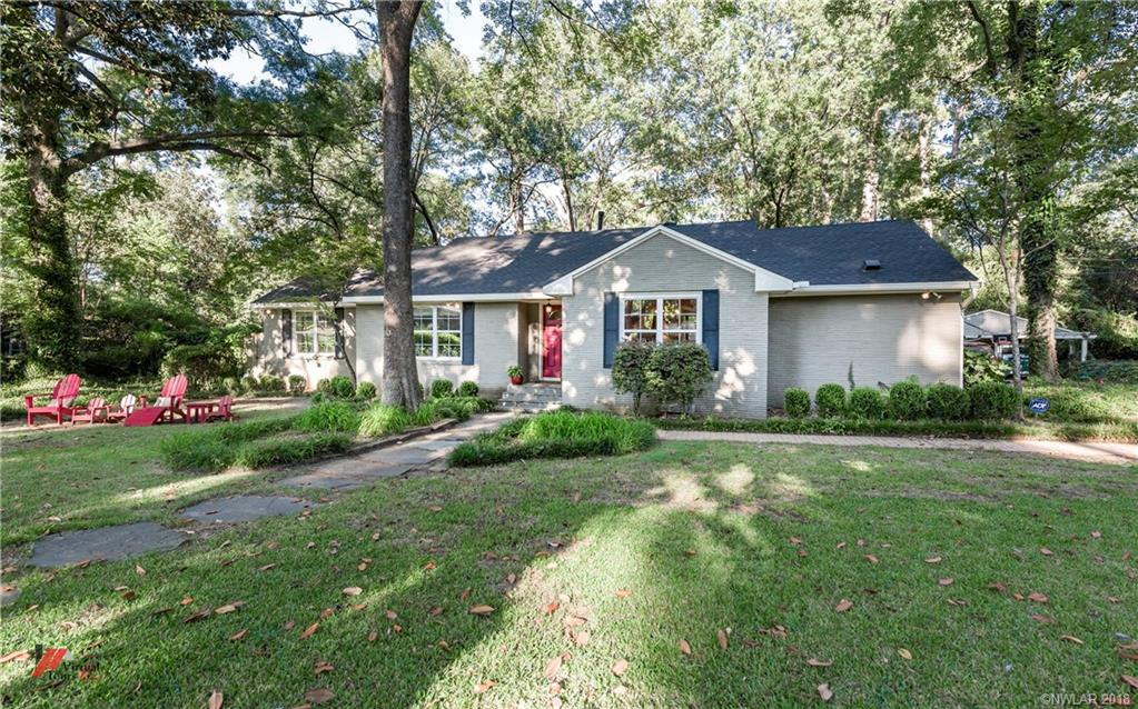 Great family home with charm and character in Shreveport's beautiful Pierremont neighborhood! Open floor plan perfect for entertaining. Custom updates throughout home make it truly one of a kind, and move-in-ready. New roof and updated kitchen. The large corner lot is fully fenced, includes a security gate and backyard privacy fence. New antique brick outdoor living space with gas starter fire pit, beautiful entertainment cabinetry and Bevolo gas lanterns. Completely updated master bath.