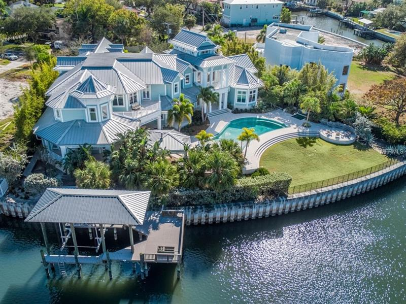 Absolutely stunning one of the kind Davis Islands waterfront estate.  This custom designed Key West style home is situated on one the largest waterfront lots in South Tampa.  200ft on the water and the majestic OPEN BAY and sunset views are exceptional.  The dramatic foyer with its soaring 30+ foot cathedral ceiling affords amazing light and boxed wood moldings.  All eyes are immediately drawn to the pool and waterfront vistas.  Downstairs features an ex-suite guest bedroom, a beautiful oversized study with a wood beamed 2 story ceiling, a formal living room, a formal dining room with unique moldings, a huge walk in wine cellar, a chef's kitchen with an enormous pantry, and a family room with fireplace.  Out in the expansive pool area the home has thousands of square feet of covered lanai space, a large outdoor kitchen with every option imaginable including a pizza oven, an enormous zero edge pool and spa, a covered boat dock, and tons of green space.  Upstairs there is a huge bonus room over the 3 car garage, 4 more bedrooms plus the master suite which has an oversized closet, gorgeous master bath, a hobby room and a private balcony perfect for enjoying sunsets.  This South Tampa beauty will charm and enchant the most discerning buyer.