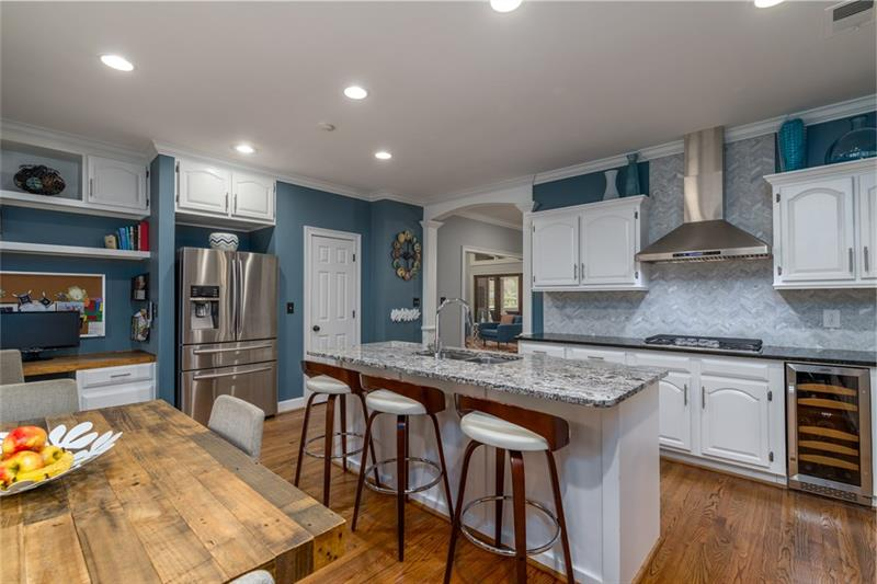 Custom range hood, separate wine cooler and separate desk area make this kitchen one of a kind!