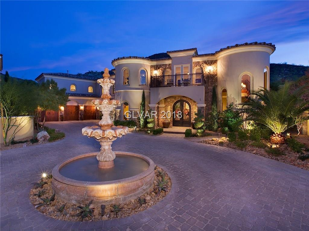 This Tuscan estate is tucked inside a quiet cul-de-sac. Three private master suites, each w/sitting area, walk-in closet & bath w/dual sinks, deep tub and world-class shower space. Theater w/wet bar & wine storage. Kitchen has professional appliances & decorator touches. Entertain guests w/your outdoor kitchen/lounge, fireplace, pool/spa & waterfall.
