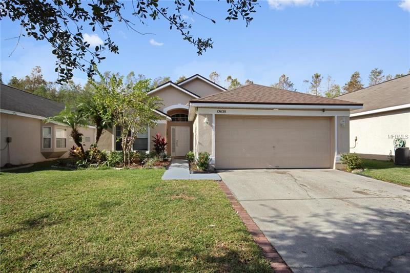 **Now's your chance to live the convenient lifestyle everyone seeks!**Right around the corner from Avalon Park, offering seasonal events, mom-and-pop restaurants/eateries, trendy boutique shopping, movie nights in the park & more. Active community with gated secure entrance, pool, playground, basketball courts, tennis courts and more. A-rated schools nearby including Ladybird Daycare right around the corner. Open, airy interior creates a beautiful atmosphere with HIGH CEILINGS, easy care tile in kitchen and entryway, abundant natural light, architectural cutouts and contemporary features like a **NEW ROOF (4/2017) an ENCLOSED SCREENED LANAI (5/2014) AND WROUGHT IRON FENCE (3/2015)**to relax and enjoy your serene view.  The family chef will enjoy whipping up a meal in the spacious kitchen overlooking the dining and living room making it easy to interact with family and guests. The split floor plan provides a private master suite and walk-in closet.  Minutes to UCF, Waterford Lakes and the 408 East-West Expressway to Downtown Orlando. Don't miss this ideal home!