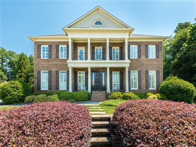 Beautiful 5 bedroom, 5 ½ BA, full brick home offering spectacular views of 14th hole of Firethorne Country Club. Grand, 2-story foyer with brick accented entrance, curved staircase & wrought iron railings. Floor-to-ceiling windows in 2-story great room allows for the natural light to really make the hardwood floors shine! The elegant kitchen has custom cabinetry, oversized island with a gas cooktop, gorgeous SS range hood, breakfast bar and breakfast eating area. Huge owner's suite has double-trey ceiling, large walk-in closets and a spa-like bath retreat! Spectacular, outdoor living area with sizable deck, full kitchen, stacked, stone fireplace, multiple stone patios and in-ground pool with fountains all fenced in for privacy!