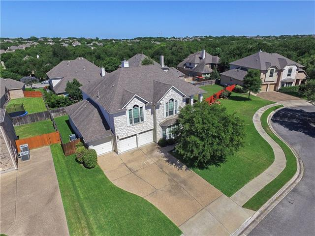 "Treed & Landscaped Cul De Sac Lot*Must See*Beautiful 18"" tile downstairs 4.18*Flooded w/Natural Light*4 Living (Family/Gameroom/Formal Living/Media/Office)*2 Dining (Formal & Café)*5 Bedrooms (Master Down) & 3.5 Baths*3 Car Garage*Family Room w/Fireplace*Open Kitchen w/Granite/Stainless Appliances/Center Island/Breakfast Bar*Owners Suite w/Double Vanities/Jetted Tub/Separate Shower & Walk-in Closet*4 Large Secondary Bedrooms*Park/Playground/Pool*Near Public Golf/Roadways & Shopping/Minutes 2 Austin"
