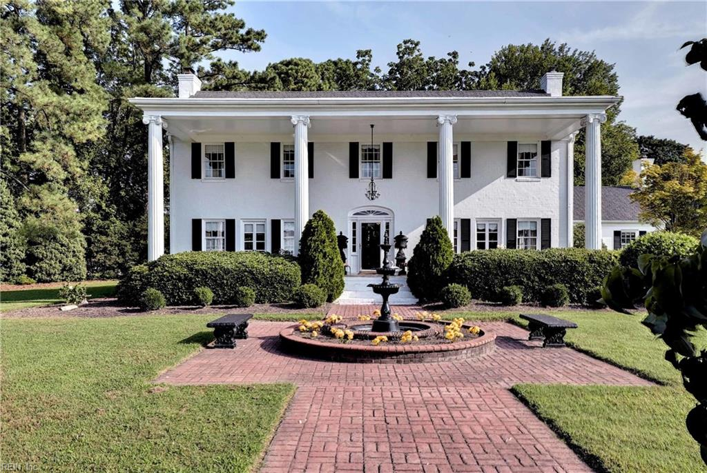 """Historic """"Bell View"""" on the Hampton Waterfront is nestled on 2.33 Acres and features approximately 655' linear feet of Hampton River and Creek shoreline.  Conveniently located just minutes from Mercury Blvd. and I-64, enter the impressive wrought-iron gate to the circular brick drive and be dazzled by Bell View!  This gracious and comfortable home exhibits the enduring appeal of traditional architecture, featuring columned veranda, front-to-back entrance foyer, 4 exquisite gas fireplaces with Italian marble mantels, hardwood floors, extensive moldings, and spacious rooms.  Second front entrance conveniently opens to the gleaming country kitchen with fireplace and white porcelain & granite floor. A 2 story waterside terrace overlooks the manicured grounds and water. There is a fully equipped guest cottage and an additional ancillary building for garden equipment and storage.  The circular brick driveway provides ample parking for cars and guests."""