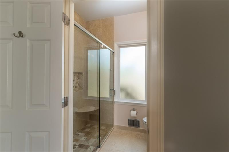 Large Guest Suite on Main Level with walk in closet and private full bath.