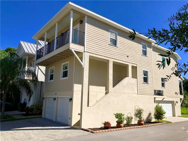 Great South Tampa location! Newer fully detached block construction Luxury Townhome with exceptional quality. Surrounded by a rapidly developing neighborhood, not only a gorgeous home with tons of space but also a great location making it an irresistible place to call home. This open floor plan is perfect for relaxing or entertaining. The kitchen features all wood cabinetry; granite counter tops and open bar to the family room with the dining area adjacent to the kitchen. Sliding doors from the family room open to the large covered deck. The main floor has a guest bedroom and full bathroom. The third floor features two additional bedrooms with balconies, the master suite, laundry room and bonus room currently used as an office. The Master suite has 2 walk-in closets, tray ceiling and an over-sized shower with dual heads and controls. The 4 car garage is over 1200sq ft and has a separate storage room. Both HVAC units have recently been replaced and upgraded and the exterior has just been painted. Close to Mac Dill AFB, Gandy Bridge and a waterfront park (Picnic Island State Park).You wont want to miss this one. Call today to schedule your private showing.
