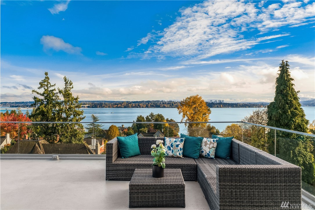 Simply Stunning 2017 remodel of a Roland Terry Northwest Masterpiece overlooking Lake Washington & Cascade Mountains. Soaring ceilings, VG Fir paneling, open floor plan, limestone & oak floors. Calacatta Marble kitchen-family room w/Miele, Sub-zero, & Wolf top-of-the line appliances. Four bedroom suites w/ luxurious finishes & baths, including tremendous master suite w/ 2 decks, Calacatta marble spa bath, extraordinary dressing room. New doors, windows, wiring, insulation. Private gardens
