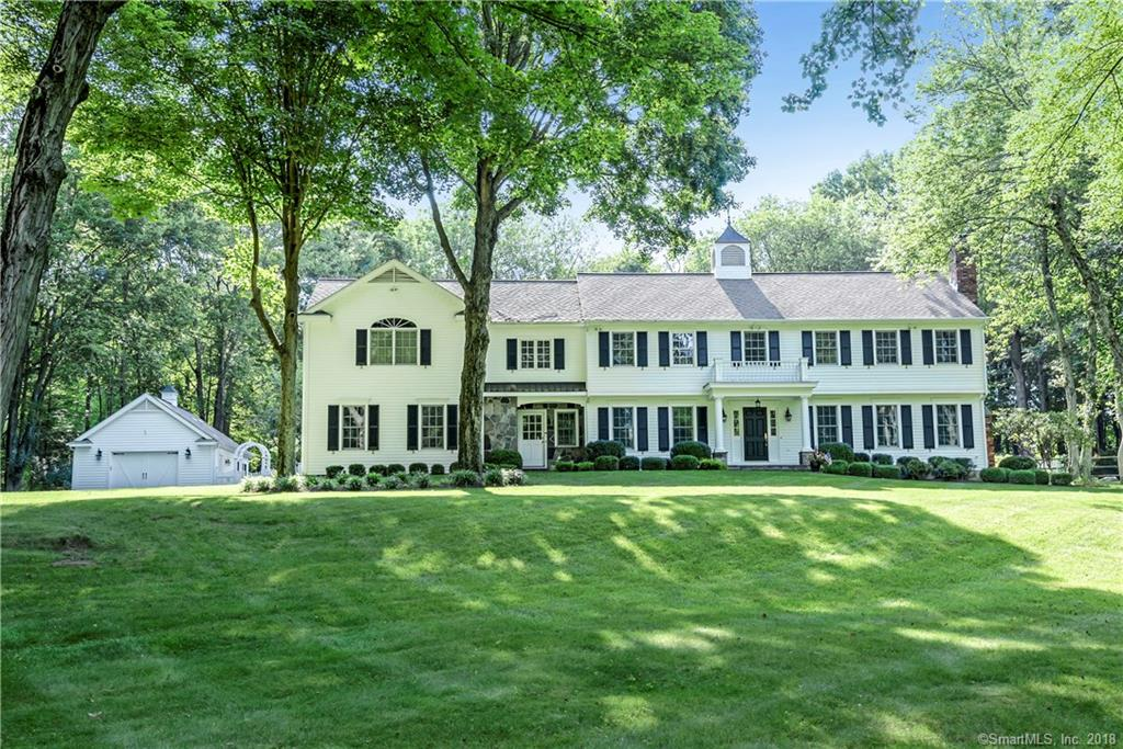 Gorgeous Classic Colonial completely renovated with exceptional level backyard with pool. Top South Ridgefield neighborhood.  Only minutes to town, this spectacular home checks all the boxes- completely updated and freshly painted throughout, exquisite mill work, 5 spacious Bedrooms, expansive level yard w/amazing pool, front and back staircases and sizable Mud Room. Distinguished Living Room/Games Room with a fireplace adjoins great Bar Room/Den & stylish Dining Room. Amazing Designer Kitchen with an oversized island, professional appliances & stunning Breakfast Room with pool views opens to Family Room with a soaring coffered ceiling & fireplace. Upper level with a large Master Suite including an oversized shower + soaking tub. Four additional spacious Bedrooms & Bonus Room. Finished Lower Level with large Game Room + Exercise Room. Rear yard is the perfect retreat with 2 level acres, extensive plantings, Gunite pool, large patio + fire pit. Great commute location. Move right in!