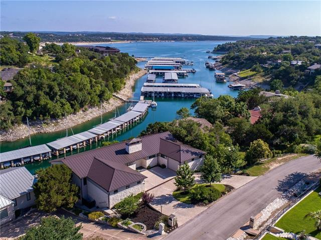 Incredible waterfront estate with expansive Lake Travis views from almost every room! This contemporary home with walls of windows, Brazilian cherry hardwoods, Isokern fireplaces has everything you could want and more.  Spacious chefs kitchen with a Viking gas cooktop, 2 dishwashers, double ovens and a double Maytag fridge. Walk down to your 2 slip boat dock or relax in your gleaming resistance swimming pool. 3 car garage with 3rd garage bay/workshop having HVAC. Live where others vacation!