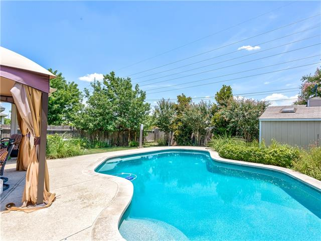 Dream backyard with sparkling pools and lush landscape. Grand entry with two-story great room open to kitchen and breakfast area. Huge windows make a bright and welcoming home. Wood flooring and tile in all living areas. 5 bedrooms + 3.5 baths + Study + Game Room + Formal Dining. So many options for use of space to make this home your own.