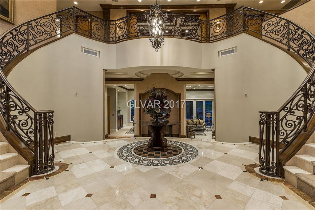 Custom Tuscan in exclus dbl gated Marseilles comm within So Shore @ Lake Las Vegas.Expansive panoramic views from all windows of Lake&Cntry Club.Custom marble,granite&stone work t/o home.5 lrg ensuites w/private decks.2 master suites,1up&1 dwn.Library/office,theater rm,temp controlled wine grotto,lrg kit w/high-end stainless steel appl,oversized sunken fam rm off kit.Curved dbl staircase leads up to game rm&2nd fam rm.