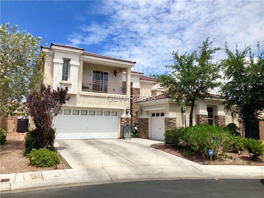 Huge 11,761 SF lot in gated community of Aliante!   Inviting courtyard with fireplace and access to attached casita with 1/2 bath.   Dramatic entry with dual staircases.  Gorgeous kitchen with cherry wood cabinets, granite counters, double oven, SS appliances, & walk-in pantry.  Luxury master suite with his & her own bathrooms, 2 walk-in closets, fireplace, & retreat with balcony.  Master suite separate from other bedrooms by catwalk. A must see!