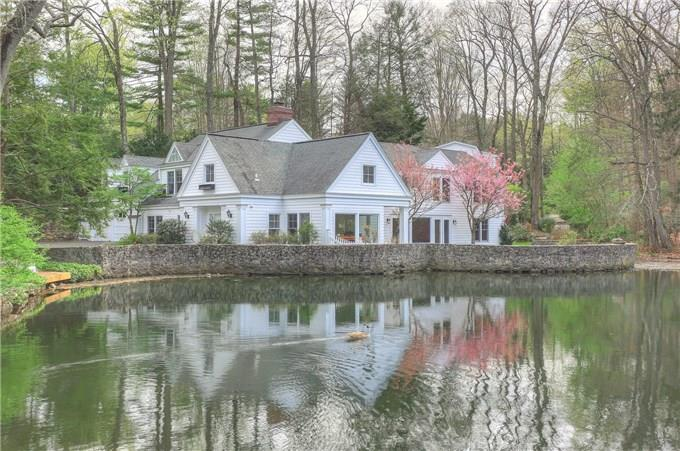 TENANT IS IN PROCESS OF MOVING OUT! THIS HOME IS BACK ON THE MARKET! Magnificent retreat on Florsheim Pond with stunning waterfall, mature landscaping & spectacular gardens. Water views throughout. Open floor plan with large windows & French doors lead to stone patio. Updated & remodeled with every creature comfort. Gourmet kitchen with outdoor eating patio. Versatile & unique. Direct waterfront oasis tucked away in private West Norwalk neighborhood on Darien/New Canaan border. Rebuilt In 1994, Expanded In '01 & Updated '06. Media room leads to large outdoor entertaining deck. Fenced planting garden, shed and boat dock. Paradise Found. Privacy & Tranquility in this amazingly serene setting.
