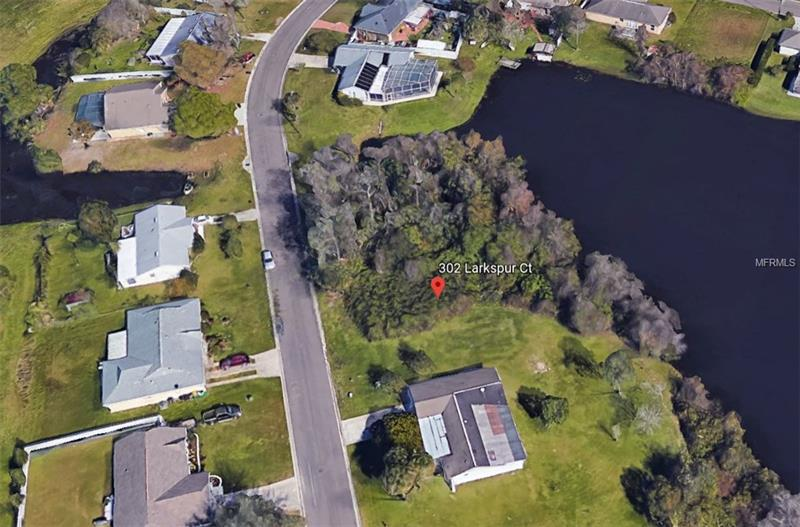 If you are looking for vacant land **WITH LAKE ACCESS**, THIS IS IT! Beautiful scenic buildable land with lake access in a well established neighborhood with NO HOA. Build your dream home and enjoy the serene surrounds in this quiet and peaceful location. Ideal location sets the stage for a truly convenient lifestyle: just minutes to shopping, hospital and medical centers and restaurants. There has never been a better time to buy and build your dream home!