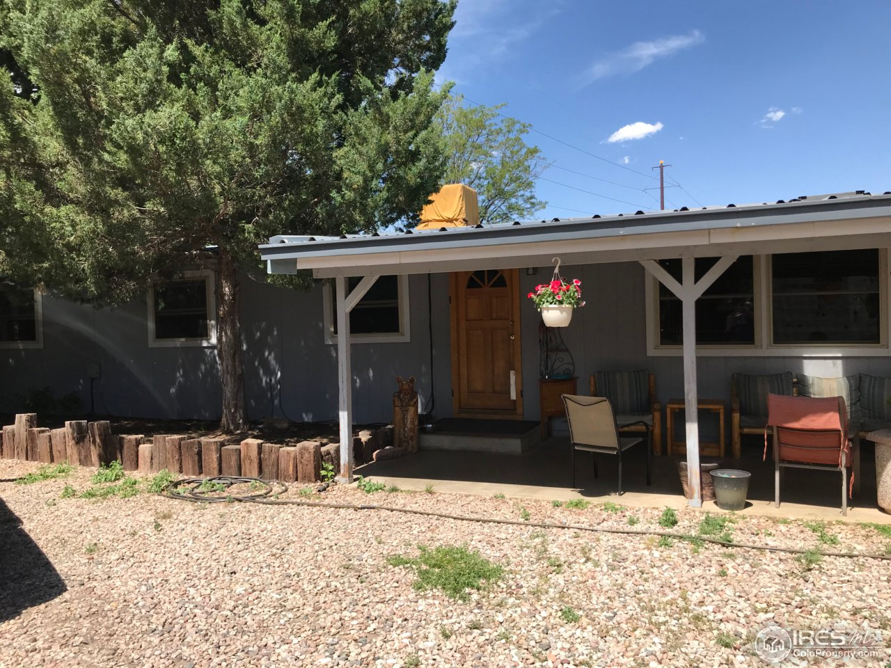 Urban farm in FoCo!Fully fenced 1/2 acre of manicured lawn and great shade trees, with chicken coops, raised bed gardens, oversize 2 car garagew/220, plenty of RV Parking & backs to horse pasture. Modular home on permanent concrete foundation w/ crawl space, upgraded copper wiring & plumbing, tankless water heater, new furnace, remodeled kitchen w/stainless steel appliances and farm sink. Open floor plan with aspen plank wall decor in living room. May be able to add in-law up to 600sq ft.