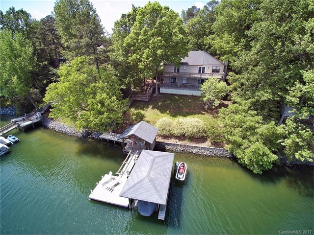 WOW! RARE Lakefront Ranch with Walk-out Basement on a DOUBLE Lot! This beautiful deep water, Lake Wylie view & access home offers: Covered Shade Dock, Open Sun Dock & Boat dock with watercraft lift and roof. Basement bar with sink & dishwasher, perfect for teens & guests. HUGE back upper and lower decks for enjoying the lake year round. Tega Cay offers many amenities: club house, beach, golf course, tennis, parks, walking/running trails, Marina and more. Enjoy an active lakeside lifestyle!