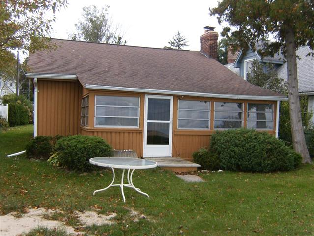 Great vacation spot on Lake Huron! 3 bedroom, 1 bath, kitchen with dinette area, great room with fireplace and sun porch over looking the beach. Laundry room off the kitchen area with exterior entrance. Newer 2 car detached garage. Steel seawall and sandy beach. Laundry room not connected to city sewer. Fireplace not recommended for wood fire. Damper not operational. Chimney motor joints deteriorated.