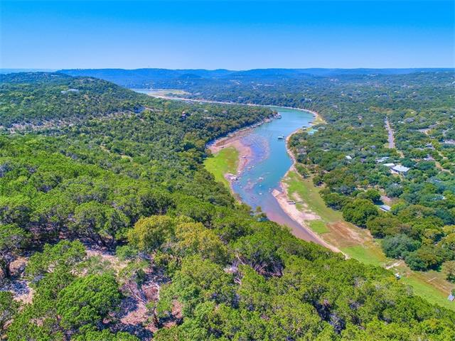 Development potential, (conceptual plan available), or outstanding ranch/estate~3 tracts totaling +/-107 acres~Panoramic views overlooking Sandy Creek Arm of Lake Travis and hill country in all directions for miles~20-25 acres contained on mesa at top of hill~About 1/2 of property in City of Jonestown & ~1/2 in Travis County~30+/- miles from downtown Austin, yet modern conveniences & entertainment abound very nearby in Cedar Park/Leander area. Property can't be split. Gate for property on Johnson Road.