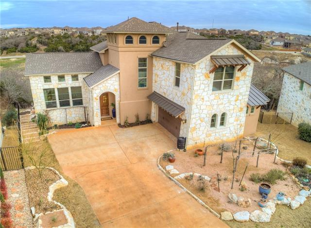 Stunning home in a private, gated golf course neighborhood! Plenty of room to entertain in this two-story Crystal Falls home that sits on a huge cul-de-sac backing to golf course! Spacious open floor plan w/master & guest suites on main, two-story living, Chef's kitchen w/double island, & hardwood floors throughout down! Huge game room, media room & study up. Covered patio w/built-in grill & amazing views perfect for alfresco dining! Located in acclaimed Leander ISD w/countless amenities for you to enjoy!