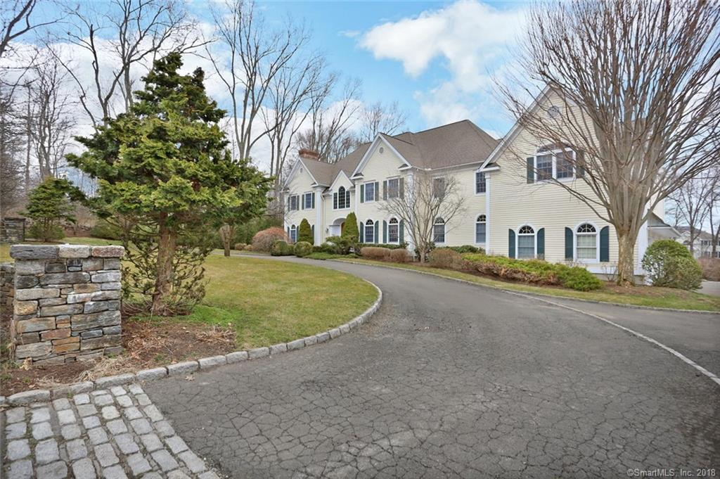 Stately Center Hall Colonial set in a sought-after convenient Wilton neighborhood.   This home has all the features, even the most discriminating buyer will fall in love.  Walk through the front door and you are greeted with a wonderful entryway and grand staircase.  The large open layout, leads you to a kitchen that a chef would enjoy cooking in.  Stunning great room with fireplace, formal living, large dining room with a Butler's Pantry and office/library.  Expansive deck overlooking the large flat yard and your very own putting green. Enormous walk out finished lower level with bar, fireplace and gym room.  The master suite will aww you.  Featuring a fireplace, spa like master bathroom and enormous walk-in-closet.  The home also boasts four additional en suite bedrooms, a large second floor bonus room, walk up attic that can be finished for additional space and extra washer/dryer hook ups on the second level. You will enjoy the lovingly cared for private neighborhood with the convenient access to shopping, train and highways.  Full House Generator.  Come see the magic this home possesses.